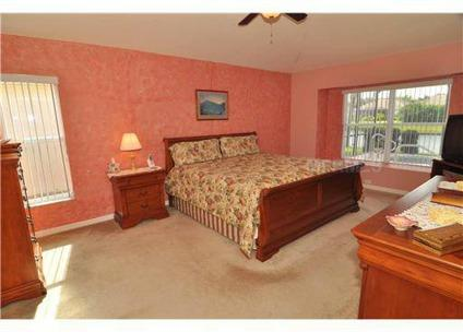 $244,900 Apollo Beach 4BR 3BA, Pool Home on pond frontage lot that