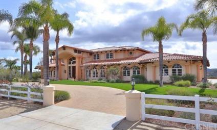 $4,595,000 6BDR 7BTH Mediterranean Style Family Home