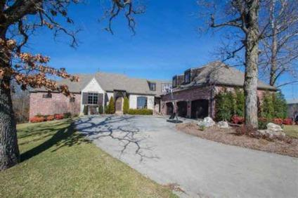 $565,000 As you walk in the front door of this Old World custom home