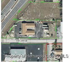 $800,000 8796sf Building, zoned C-2 on 1.47 acres with 200+ft of frontage on U S Hwy 19