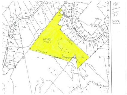 $95,000 65 Acres with a gravel driveway extending well into the acreage.