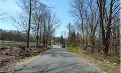This wonderful wooded lot features 12.88 acres and has a babbling brook and is lovely property to enjoy nature! Listing originally posted at http