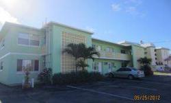 Oceanfront complex! Great opportunity to live on the BEACH, VACATION here, or use as a RENTAL INVESTMENT. 2br/1ba first floor. This cozy condo is a fully furnished corner unit with ocean views. New tile thru-out. On site rental management and laundry
