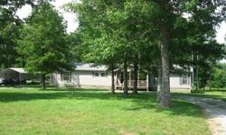 Five acres with trees and fenced with large 3 bedroom modular home with carport, outbuilding, dog run, and two tiered deck. The living area is vaulted and large with stone fireplace. The kitchen has plenty of cabinets and a center island, desk, and eating
