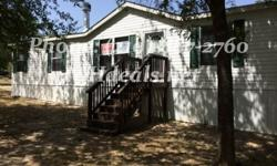 A gorgeous 4 bed 2 Bath Used Double Wide Home on .72 acres of land. With 1,512 square feet (27 x 56) and many features this home is perfect for both new and experienced home buyers. The home is in a great corner lot location, just minutes from town. It is