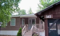 "PRICE IMPROVEMENT!! MOTIVATED Seller--may consider some owner financing. This is ""luxury camping"" at it's best! Immaculately maintained, turn key Park Model with large, professionally built knotty pine addition. Turn key...just bring your tooth brush."