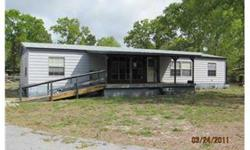 Large mobile home located on over an acre of property. Property is fenced and features an above ground pool with wood deck. Mobile has three bedrooms with split plan. Bedrooms: 3 Full Bathrooms: 2 Half Bathrooms: 0 Lot Size: 0 acres Type: Single Family
