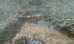 Over 1/two mile road front. Scenic Grease Creek flows through. Cemetery reserved. Timber to be cut. Perk approved.Listing originally posted at http