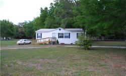 A MUST SEE, country living with space to enjoy, this beautiful property is 1.58 acres with lots of mature oak trees, and close to everything. A newer 3 bedroom 2 bath mobile home, spacious floor plan, with all appliances included, situation with a