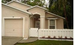 Move right in this lovely end unit villa with large eat in kitchen, living room with cathedral ceilings and skylights. Master suite with large walk in closet, opens to lanai which overlooks wooded area. Freshly painted inside a lovely neutral color, ready