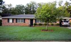 This brick home is beautifully appointed with quality lighting and fixtures throughout! The Large eat-in kitchen with flat-top cooking surface & generously sized breakfast bar is open to the family room, which makes entertaining or just feeding the family