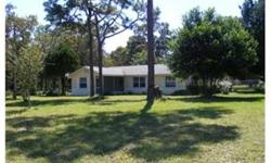 This large corner homesite has already been divided into two parcels and may be divided again. Currently this homesite includes a spacious single family 3 bedroom/2 bath pool home that has many new features and is move in ready. Enjoy almost 5 acres of