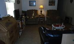 I am selling a 14x70 2 bed 1 bath mobile home on a 50x100 lot there is no lot rent you will own the lot. Quiet neighborhood mobile home sits on a private lot with wooded land in in front and behind it no one lives in front or beside it. This is NOT a