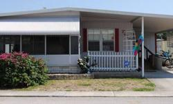 It is a 1977 double wide home with a net price of 12,500 as is or 14,500 with new floors. It has 2 bedrooms and 2 bathrooms with walk-in closets in every room. It is very spacious, including a front patio with wooden floors. Includes a brand new roof, new