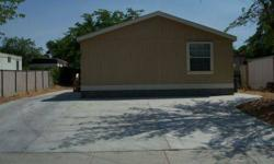 This is a great opportunity to buy a home that has been lived in less than 6 months. An open floor plan invites you in to a spacious living area with lots of windows for natural lighting. A ceiling fan may be added to the coffered ceiling with down
