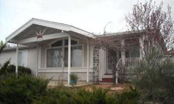 Newer two bedroom, two bath home on a beautiful corner lot in the Hawksview subdivision of Plymouth, CA. Home also has an extra room that can be used as an office or guest bedroom. Two car garage, privacy fencing in backyard. Covered patio in front and