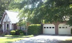 Vacation at home! Inground pool & private backyard. Master on main, 2 bedrooms up. Great room with woodburning fireplace. Large 2 car garage with workbench opens to backyard pool area. Water proof speakers. Flooring allowance. Cedar lined walk-in attic