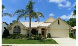 IMMACULATE BEAUTIFULLY LANDSCAPED HOME IN FAIRWAY OAKS & ON GOLF COURSE!! This 3 bedrm, 3.5 bath, 2 car gar SOLAR HTD POOL hm opens to a luscious interior to call HOME. w/ctr island-access to lanai/pool area. Corian kit countertops, many cabinets. Inside