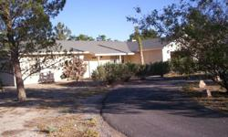 Beautiful spacious 3 bed room, 2 bath, ranch style home in Pahrump Nevada, on about 2 acres. Home is well cared for, formal living room, and separate huge family room with a wood burning fire place. Nice trees and land scape, covered patio, and sprinkler