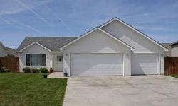 Tremendous 2 bed, 2 bath house - just a block from The Fairways Golf Course. Vaulted ceilings, open kitchen, brand new tile flooring and an oversized 3 car garage are just some of the great features. Fully fenced yard with a sprinkler system and a large
