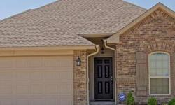 Woodwind, an Edmond Community... Featuring granite counters in kitchen & bathrooms. Corner gas fireplace overlooks the living area. Kitchen offers stainless appliances, an under mount sink & breakfast bar viewing the dining room. Tray ceiling and walk-in