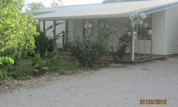 HOME, TWO SHOPS in Plainview DistrictNEED IT GONE- 2BR/1B on 7/8 of Acre. 1100 sqft, vinyl siding, metal roof, inside remodeled recently, 10x24 covered porch. Ardmore address but Lone Grove phone, cable, SOWC & total electric. Chainlink completely around