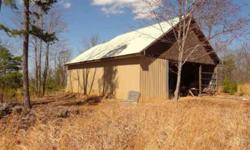 Beautiful view, 45 x 36 garage with a great spot for a cabin or home next to it.