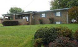 Tusculum location, all brick exterior, attached carport; 3-4 BR! YES! Just what you have been looking for! All one level living, with the added bonus of a den, 4th BR, workshop area and 2nd laundry room downstairs. Main level features a large kitchen with