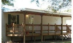 Beautiful Country Setting! Newer 2 bedroom, 2 bath modular home on 1.57 acres that is completely fenced in with a gate. Beautiful large eat-in kitchen with snack-bar counter opens up to a spacious family room with cathedral ceilings. Spli t bedroom plan