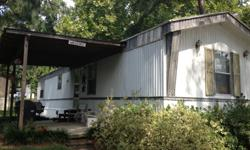 This is a 2 bedroom, 2 bathroom 2001 16 X 60 ft trailer that was remodeled in 2007. There is also a living room, kitchen, covered front porch, fenced-in back yard with separate storage facility. All amenities are included (washing machine, dryer,