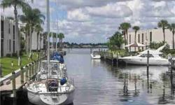 GORGEOUS VIEWS OF A BEAUTIFUL MARINA/ BOAT BASIN THAT LEADS OUT TO PICTURESQUE VIEWS OF THE WIDE RIVER FROM THIS WONDERFUL 2/2 CONDO IN A FABULOUS RIVERFRONT BOATING COMMUNITY. SPANISH TILE THROUGHOUT AND NEWER APPLIANCES. COME ENJOY THE VIEW AND BRING