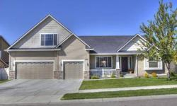 This exquisite single level home with bonus room is immaculate and move-in ready! Boasting almost 2100 sf, vaulted ceilings, a popular split bedroom floor plan, and abundant natural light, this home has two spacious living areas and four bedrooms or three