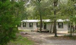 This 3 bedroom, 2 bath manufactured home with over 1600 sq ft of living space is privately situated on 11.35 Acres of rolling hills and pretty oaks. Like golf? This property was formerly used as a 9 hole golf course. It comes with irrigation system, 600