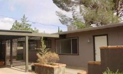 Location, Location ! Check out this cutie! 2 bedrooms and 2 baths, large living room and formal dining room. Nice size kitchen with many cabinets (needs appliances). 2 car covered carport with storage cabinets.Front patio has views of the Red Rocks.walk