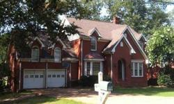 Located in Corinth's prestigeous North Hills. Located on a the west Lake. Sit on you large deck, sip coffee, and watch the ducks swim and the squirrels play. This Georgian style home has both formal living and Den, with 2 fireplaces, f. dining. Also