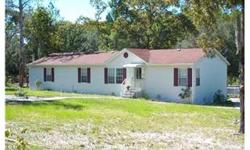 SHORT SALE - Live in a private park like setting in this attractive, true triplewide mobile home with large country kitchen with deck and pool on 1 acre. True 4 bed, 2 bath, with large custom parking pad, fully fenced with iron gate at driveway entrance.