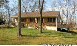 PRIVATE SETTING JUST MINUTES FROM 262 LOOP. HUGE GATHERING ROOM WITH FISHER WOOD STOVE TO SUPPLEMENT HEAT PUMP. SPACIOUS KITCHEN WITH ABUNDANCE OF CABINETS, WORK SPACE, BAR AND DINING AREA. PORCH ACROSS FRONT, 39'X10' DECK, 28'X14' STORAGE BUILDING WITH