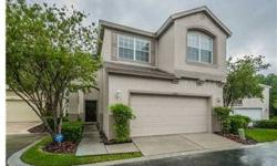 """Not a Short Sale! Seller can close quickly! Enjoy MAINTENANCE FREE lifestyle of a townhome in this single family home at """"The Enclave"""" in Westchase (gated community). Excellent condition---just move in! Gorgeous Brazilian Cherry hardwood floors downstairs"""