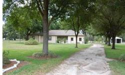Wonderful block home on 3.9 acres with 2 huge detached buildings. Home offers a nice large floor plan with over 2500 sq ft, parking for 3 cars, large screened porch in back and large covered porch in front. Detached buildings have electrical and lighting