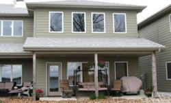 *GORGEOUS LAKE PROPERTY PRICED FAR UNDER APPRAISAL VALUE * This Home appraised in January 2012 at $205,000. Maintenance Free Living on the Lake! Gorgeous 4 Bedrooom Condo on Round Lake. Beautiful wood floors, entire east wall has windows facing the lake,