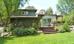 Single Story home that looks out on to mountain views, creek, and pool. Lovely creek on the side of the property on approximately 1 acre of land. Amazing separate building houses a complete recording studio or can be a great guest house with deck, views,