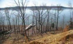 With a gorgeous 22.5 acres running over a mile along the shore of Kentucky Lake, this is one of the largest tracts of lakeside property anywhere in Tn. From the water's edge to its soaring panoramic bluff building site this land is a retreat in itself