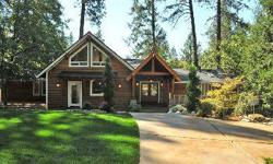 Ultimate Luxury in the Pines! Amazing and exquisite luxury home on a breathtaking landscaped parcel surrounded by waterfalls and the tall pines. Walnut wood floors throughout, Cherry spiral stair case, and gourmet kitchen with Thermadore appliances,