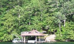 This is the best building lot available on Lake George, immediately north and contiguous to the Lake George Club. 183' of prime waterfront including a large boathouse and docking complex with stone staircase. Spectacular views across the open lake from