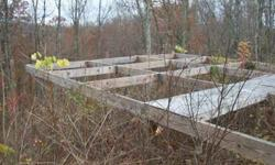 14 beautiful wooded acres in Linden, Tennessee. Great for hunting or building that vacation place. Some work on the basic structure has been done. Eighty five miles to Nashville and about the same distance to Memphis. Loretta Lynn's place is located 30