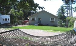 Location, Space & Room to roam plus a fabulous View of Puget Sound & Oro Bay. New front landscaping. 4 bedroom, 3 bathroom, 2,290 sq ft home is situated on a 1+ acre parcel in Cole Pt Heights. Home features lots of living space, a jetted tub and Sauna in