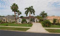 GORGEOUS POOL & LAKE VIEWS~~This SPACIOUS 3/2/2 home with SOLAR HEATED POOL is located in the gated GOLF COURSE community of SABAL TRACE with low homeowner fees. Disappearing sliding glass doors allows you to feel as though you have brought nature inside