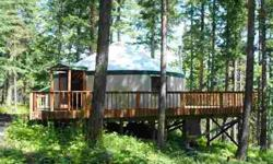 The perfect getaway place for those who want to rough it--in style. The 15 view acres includes a 700 sq. ft. yurt on a large permanent deck and provides the amenities of home including electricity and phone service. The owners have drilled the well for