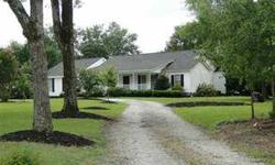 4 bedroom, 3 bath home sitting on almost 2 acres. 1100 sq ft addition in 2008 creating a huge master suite. Large living room and dining room lead into eat in kitchen with walk-in pantry with cabinetry creating more work space. Sun room with ceramic tile