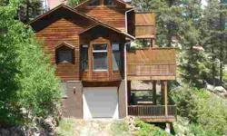 Perfect mountain home or vacation getaway on almost 3 acres of trees and large boulders with breathtaking views. Cozy, covered front porch and three decks for easy outdoor living. Custom designed two story cedar mountain contemporary design, lots of